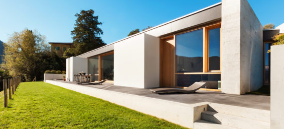 beautiful modern house in cement, view from the garden
